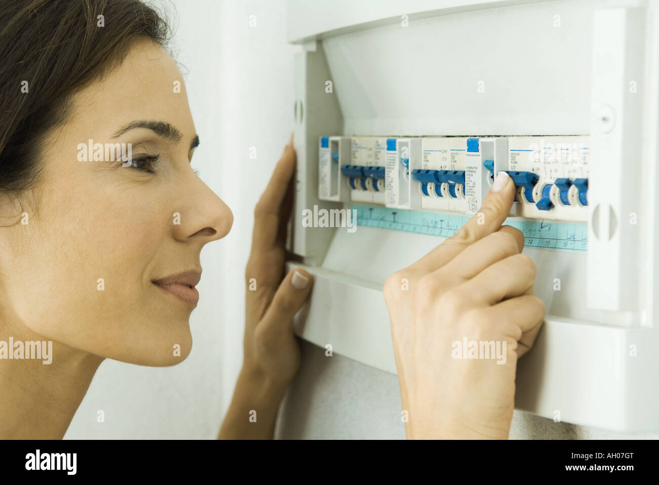 Domestic Fuse Box Stock Photos Images Alamy Ah Woman Pushing Lever In Image