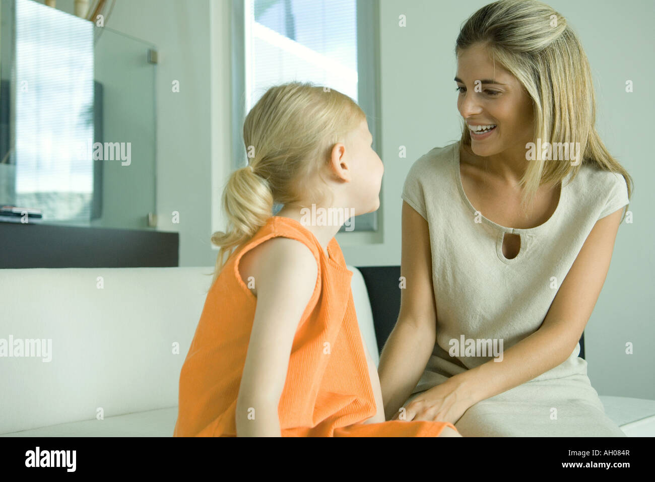 Mother talking to little girl - Stock Image