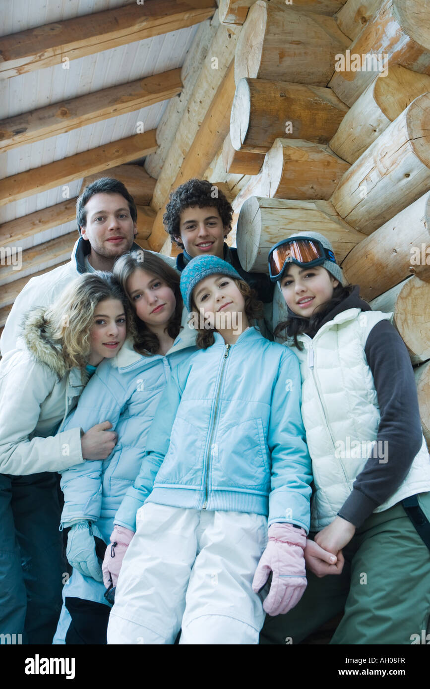 Group portrait in winter clothes, three quarter length, low angle view - Stock Image