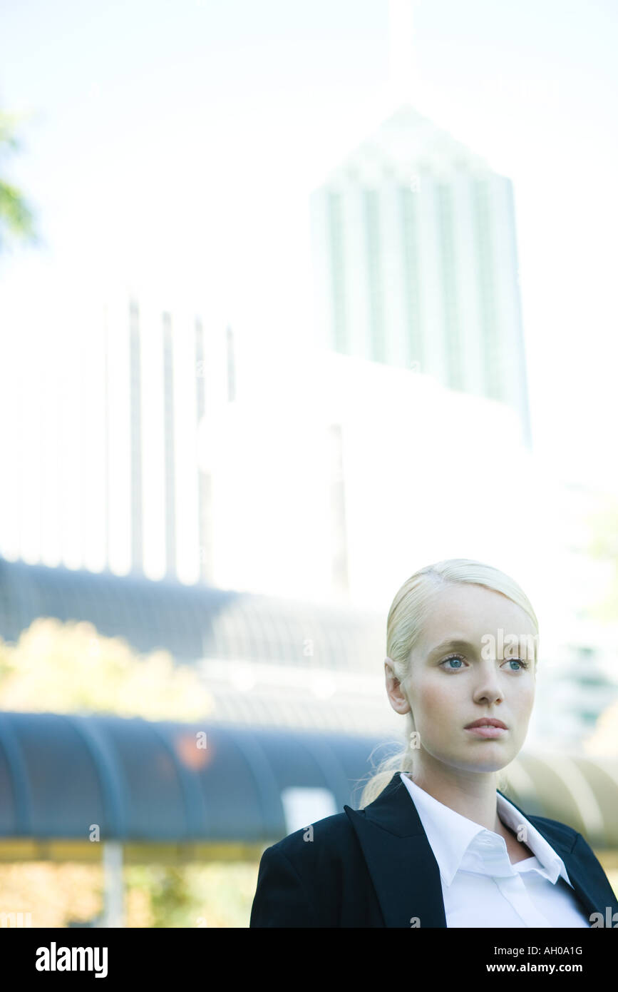 Young businesswoman outdoors, head and shoulders, portrait - Stock Image