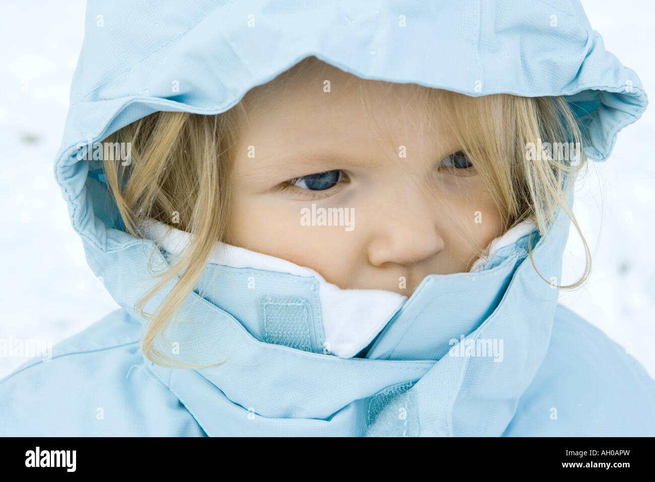 Toddler girl wearing winter coat, close-up, portrait - Stock Image