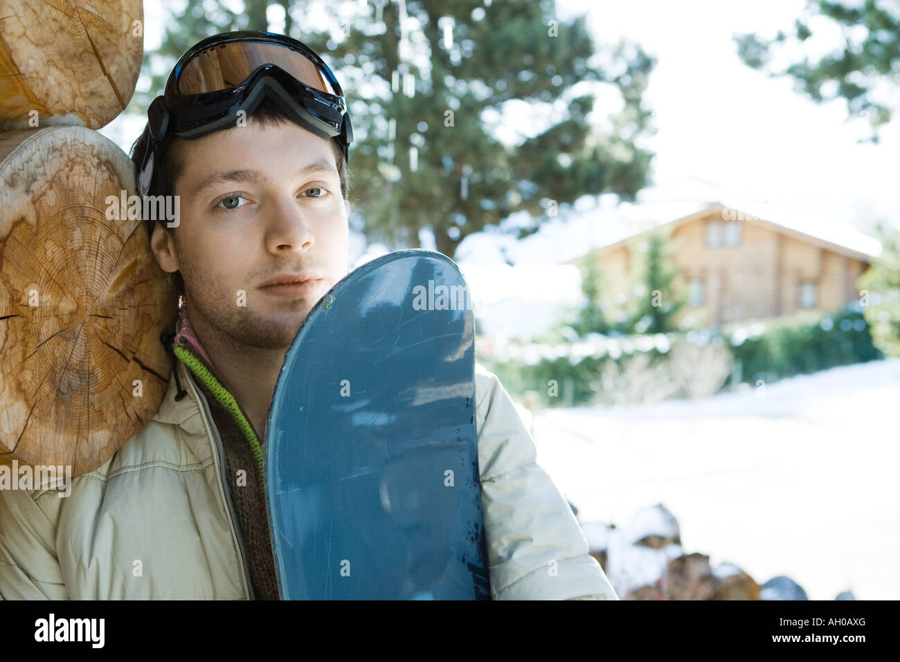 Young man with snowboard, portrait Stock Photo