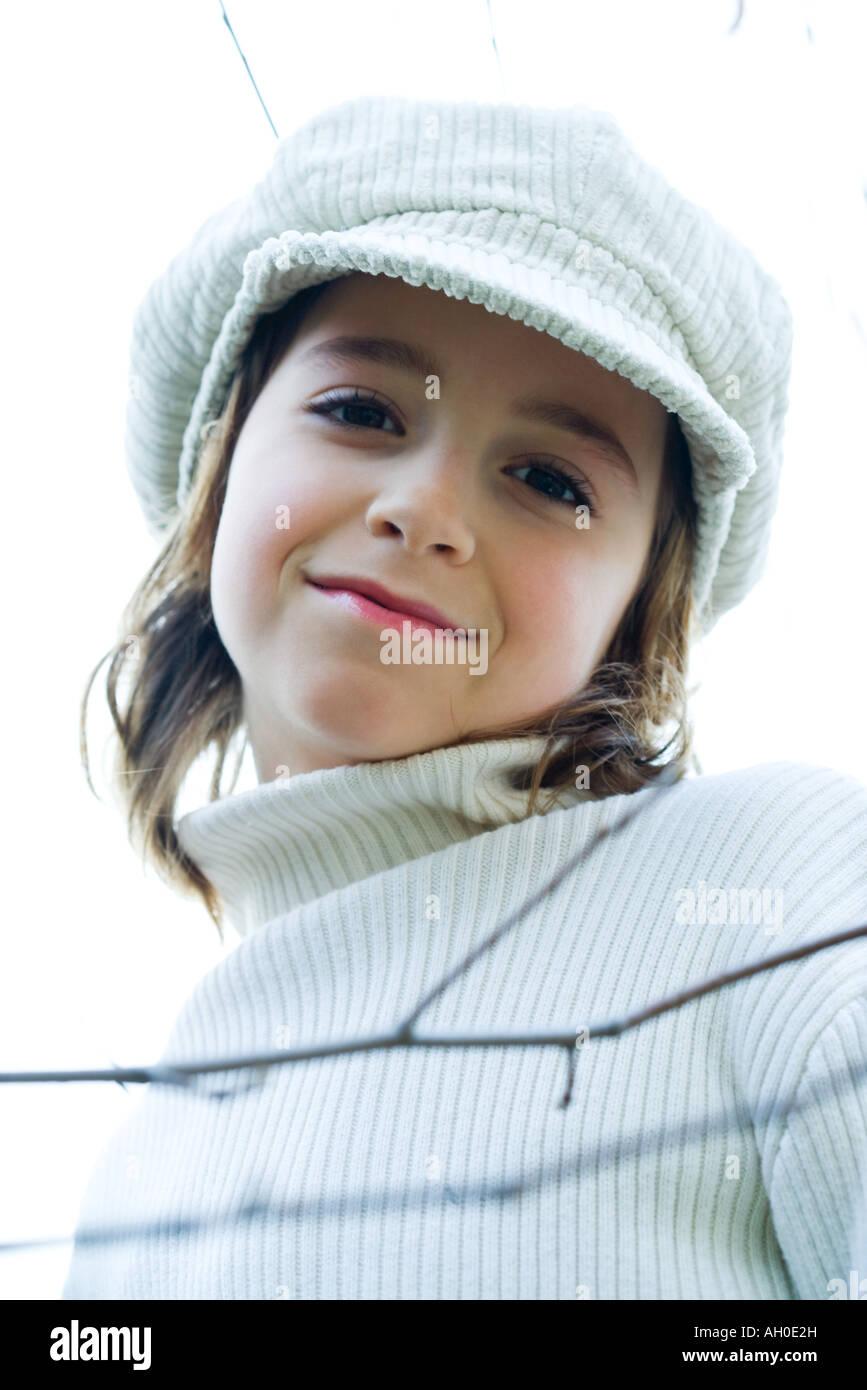 Girl wearing cap, portrait - Stock Image