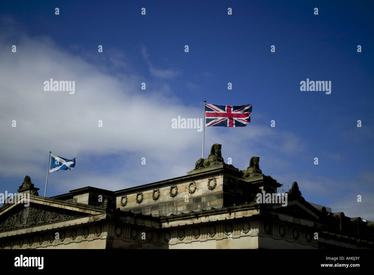 Saltire and Union flags fluttering in the breeze, The Mound, Edinburgh, UK, Scotland, Europe - Stock Image