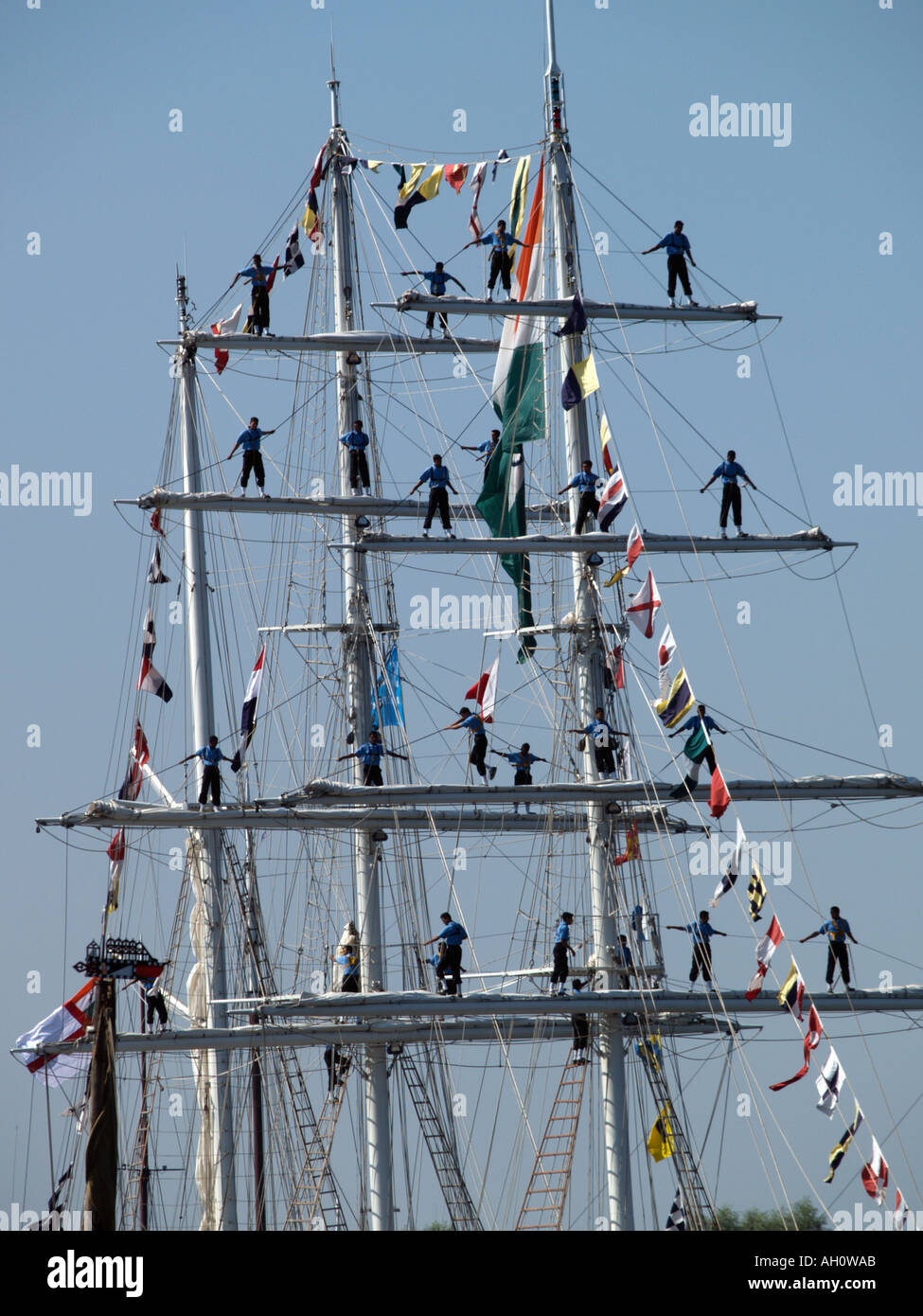 Masts and yards of the Indian tall ship INS Tarangini with sailors aloft Sail Amsterdam tall ship event the Netherlands - Stock Image