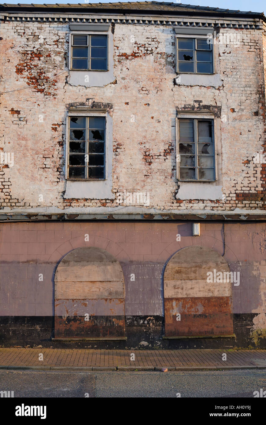 Semi derelict building suffering from urban decay in Widnes Cheshire England - Stock Image