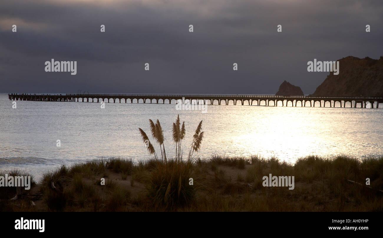 sunrise over wharf at tolaga bay east cape - Stock Image