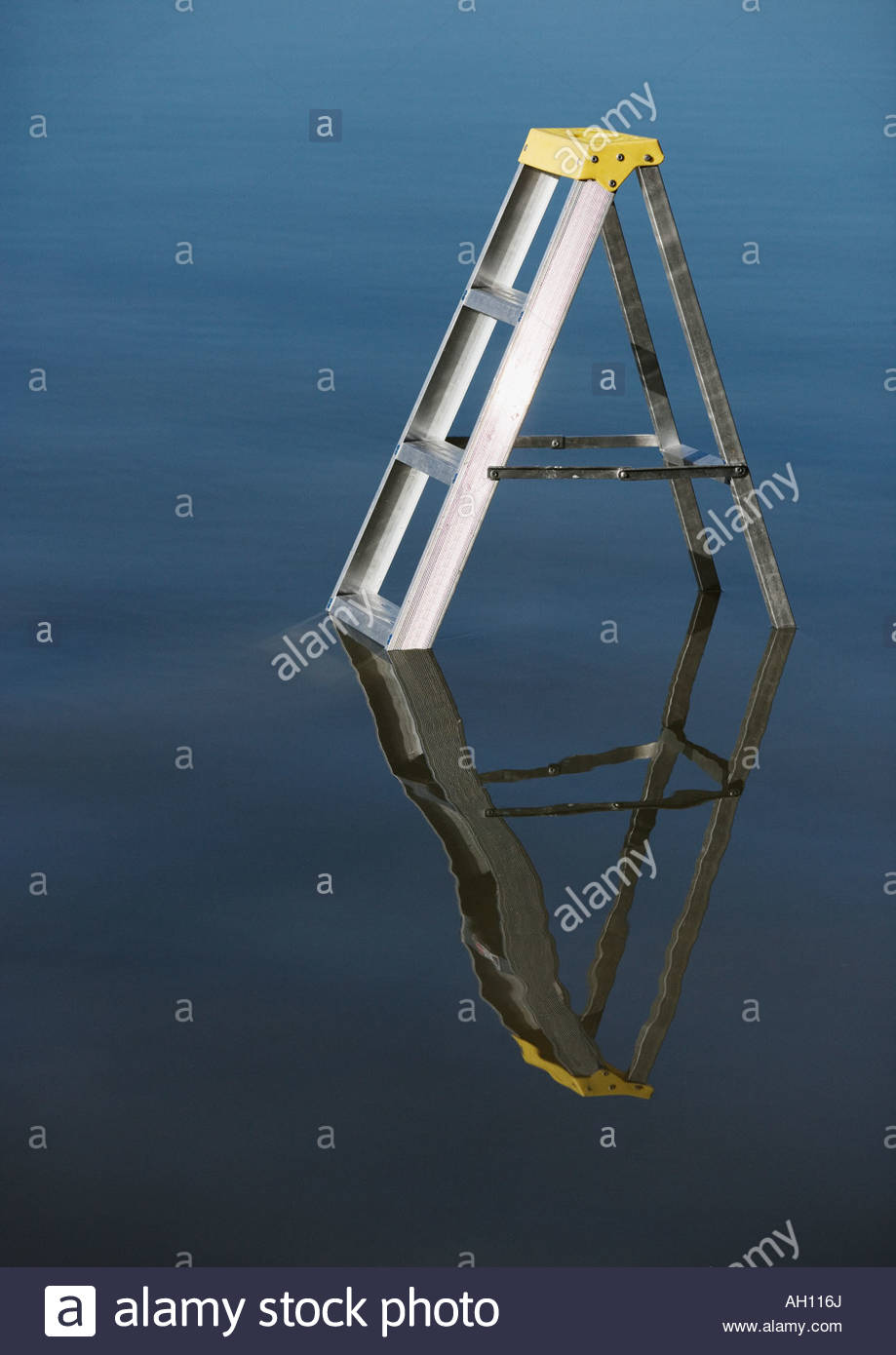 A ladder submerged in the water - Stock Image