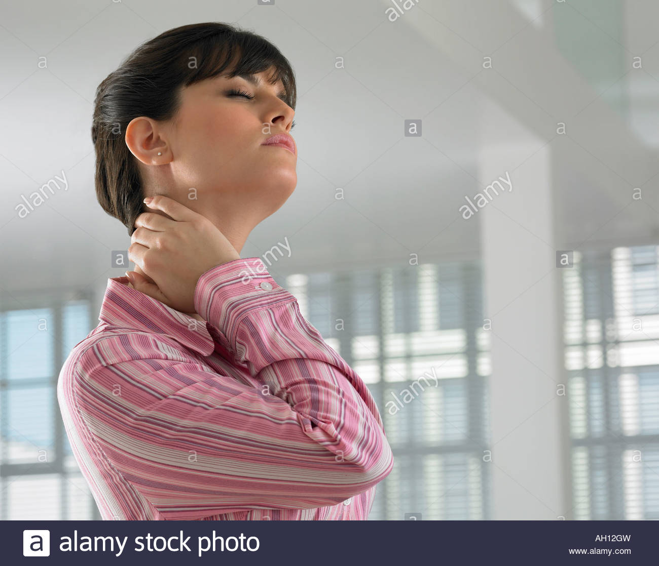 A woman dealing with stress - Stock Image