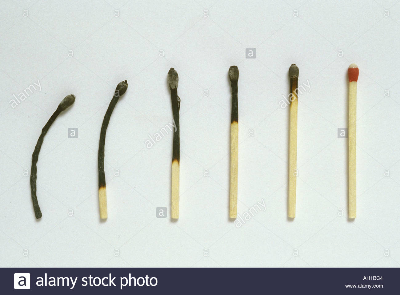 succession of matches from unused to charred - Stock Image