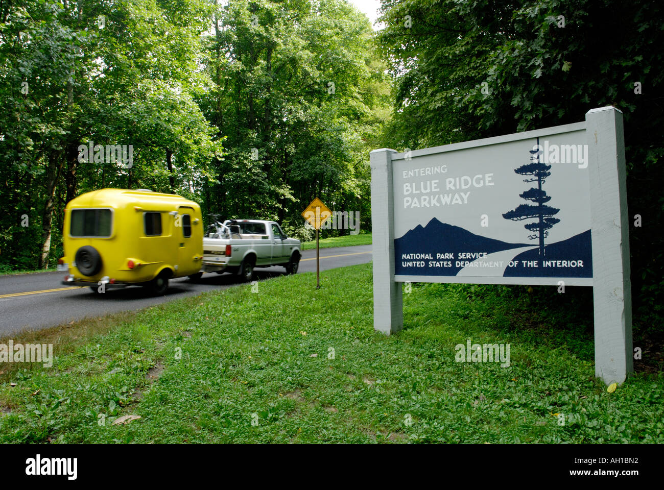 Family with camper trailer entering Blue Ridge Parkway, North Carolina - Stock Image