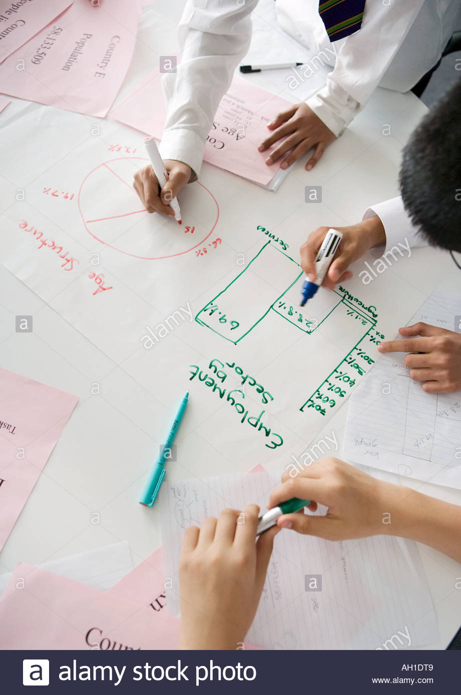School boys working on maths logic and geography work - Stock Image