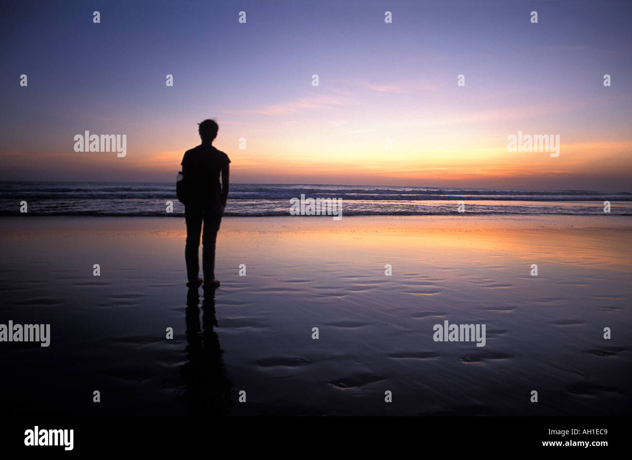 Standing on a Balinese beach looking out at sunrise sunset Bali IndonesiaStock Photo