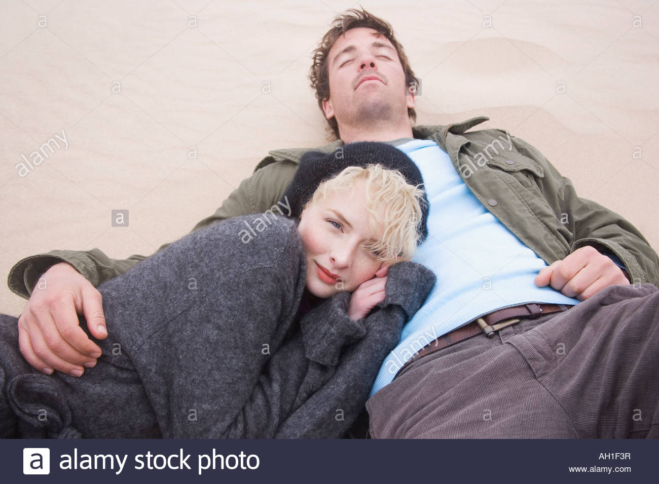 A couple at the beach - Stock Image