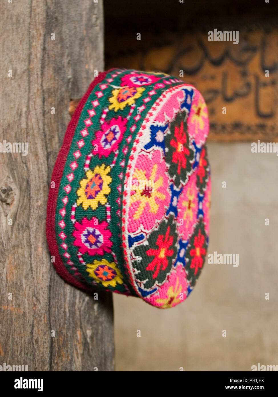 traditional pillbox hat worn by the women of Gojal up into the Pamirs northern Pakistan Stock Photo