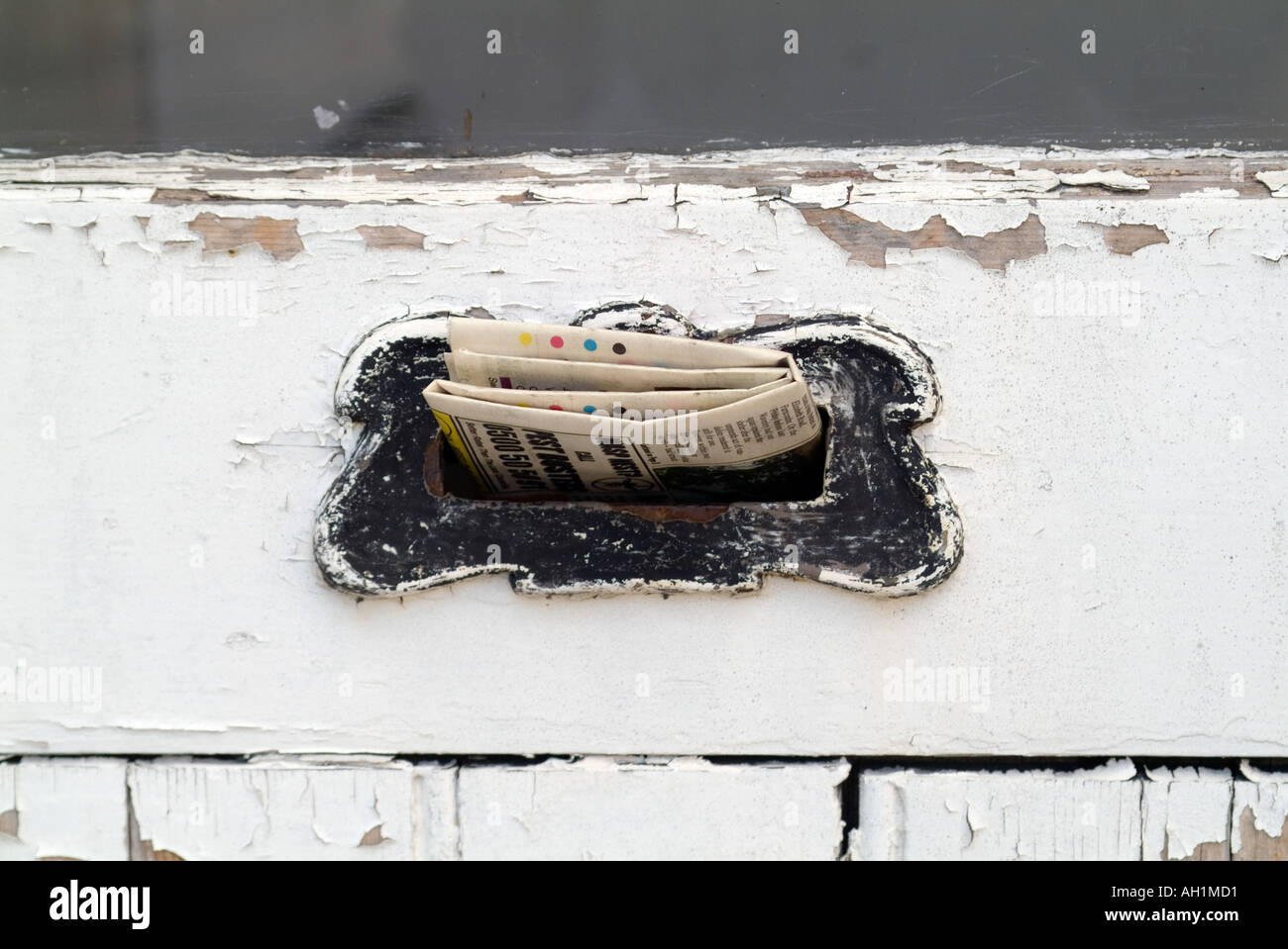 Letterbox in white painted peeling door - Stock Image