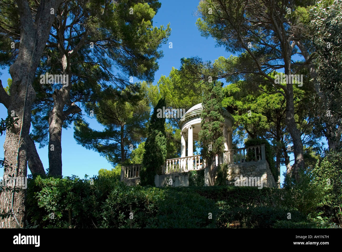 An architectural folly set among the trees in the garden of Villa Ephrussi de Rothschild at St Jean Cap Ferrat on - Stock Image
