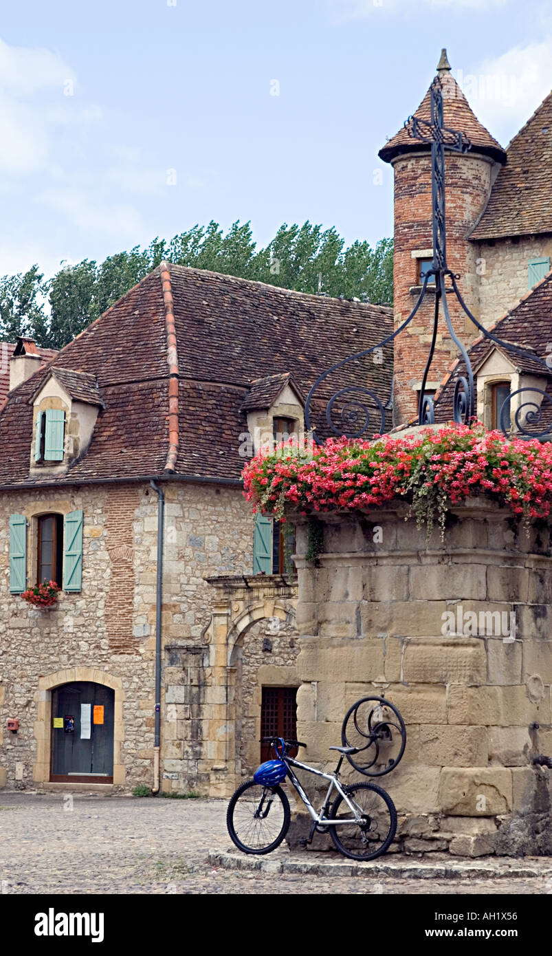 Bastide village of Bretenoux Dordogne 2005 village square with bicycle Stock Photo