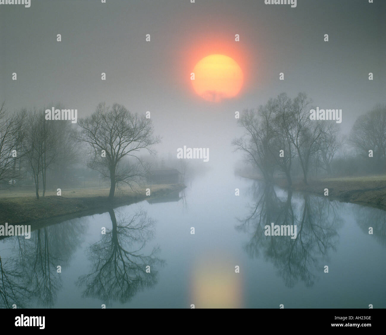 DE - BAVARIA: Sunset over River Loisach entering Lake Kochel - Stock Image
