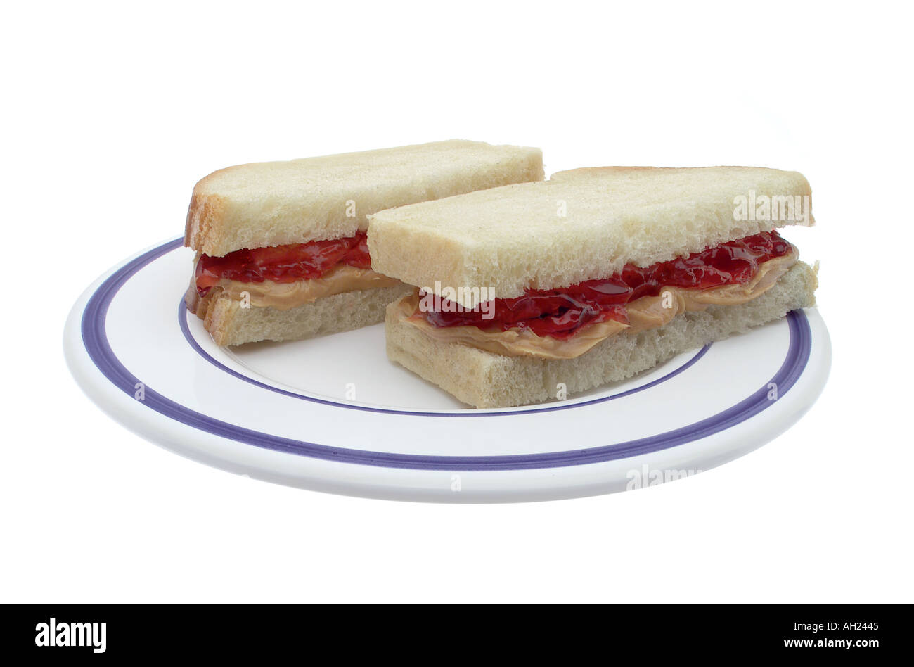 Peanut butter and jelly sandwich silhouetted on white background - Stock Image