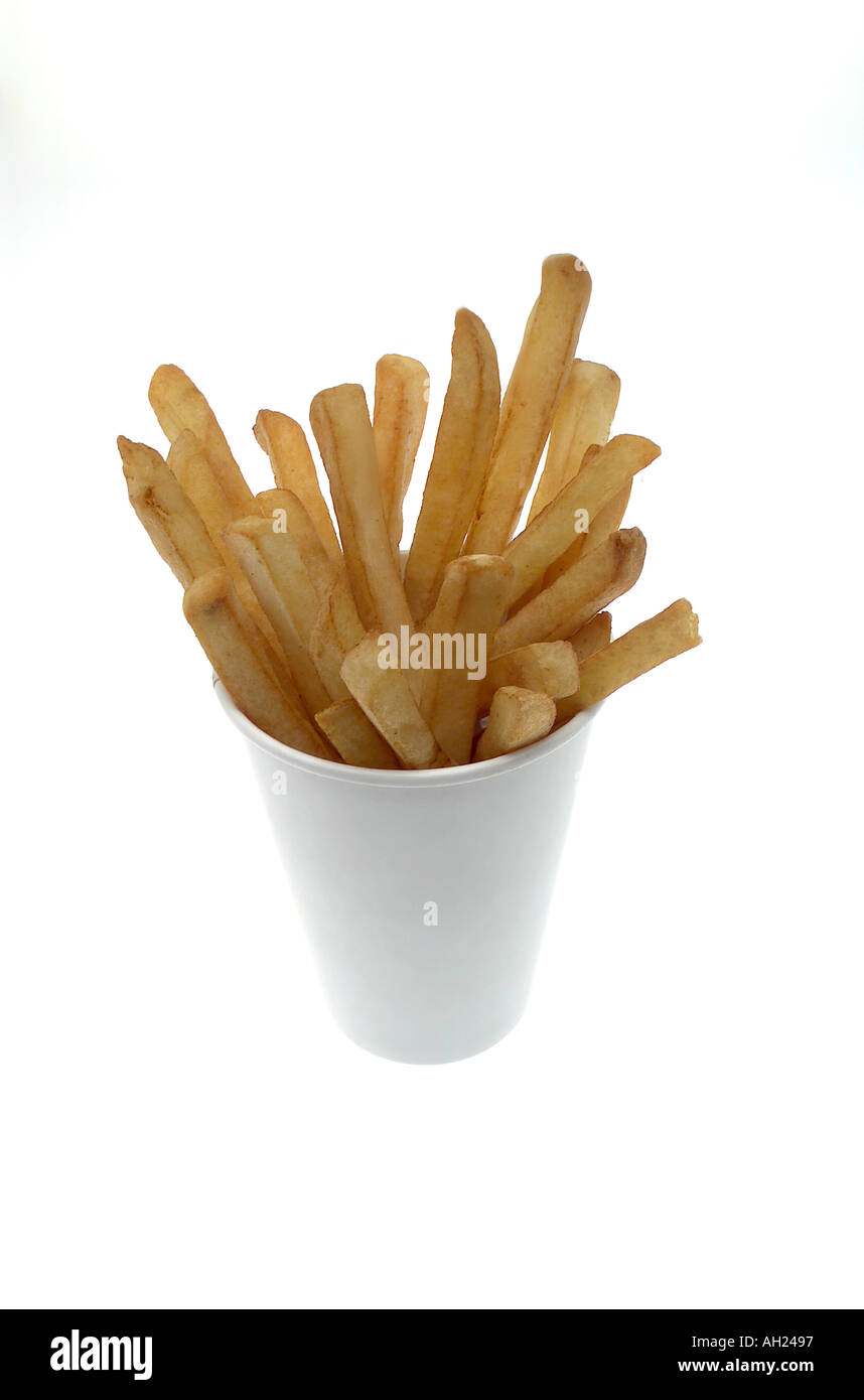 Overhead of french fries in a white take-out cup silhouetted on white background - Stock Image