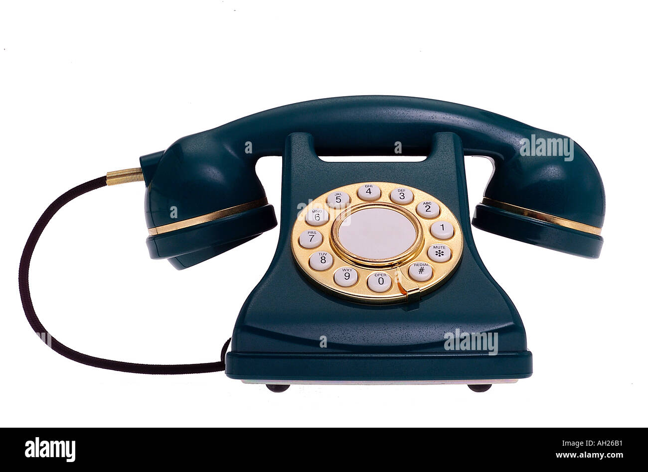 replica green and gold telephone silhouetted on white background Stock Photo
