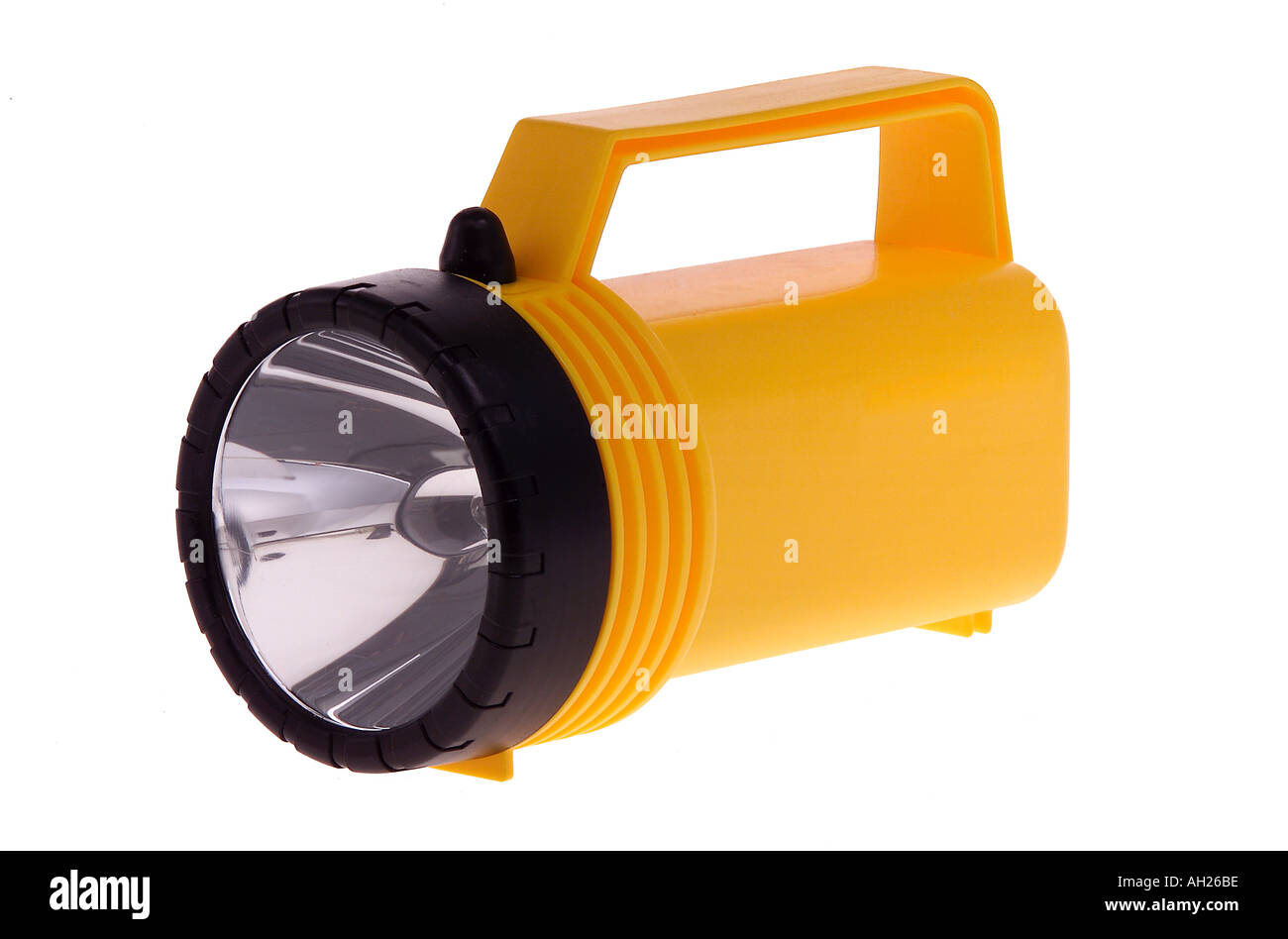 big yellow flashlight silhouetted on white background - Stock Image
