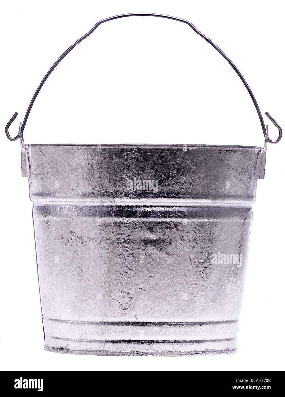 empty grey metal tin pail bucket silhouetted on white background - Stock Image