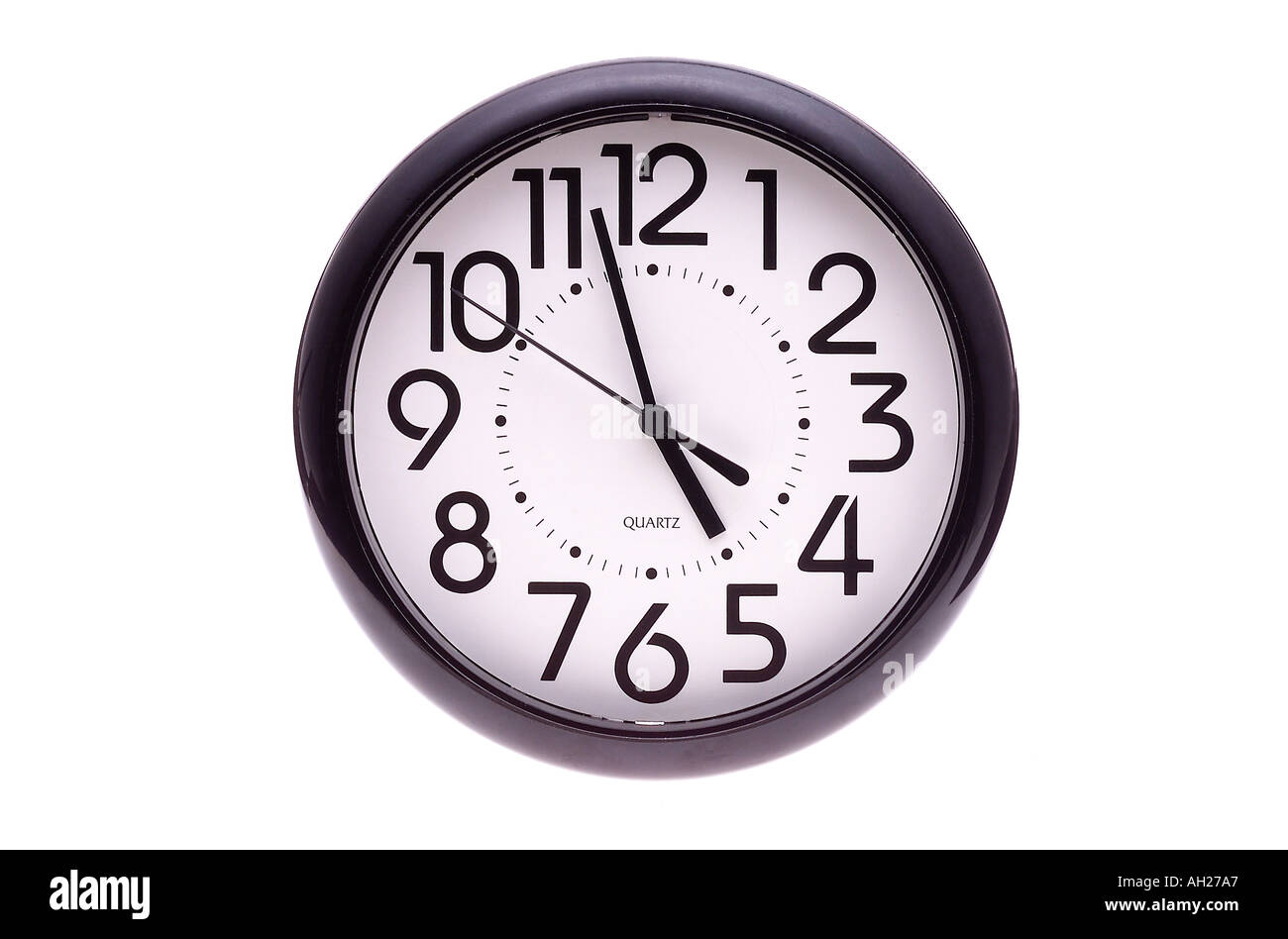 wall clock four fifty eight 4 58 silhouetted on white background - Stock Image