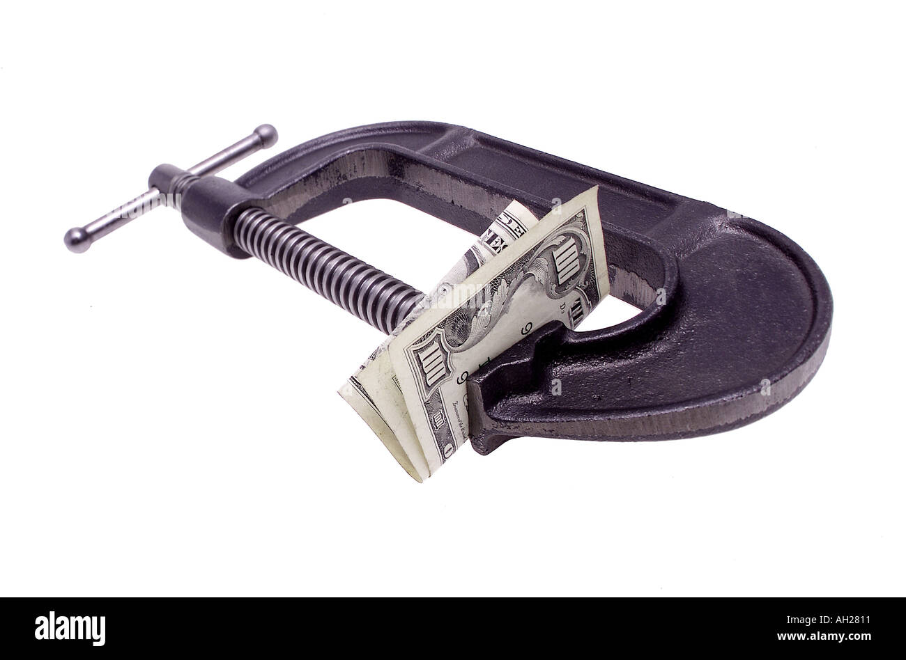 hundred dollar bill in a C clamp silhouetted on white background - Stock Image