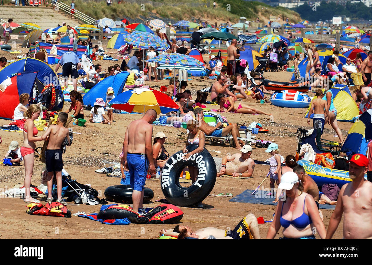 Sunseekers pack the beach at Dawlish Warren Devon on a hot Summer's day Stock Photo