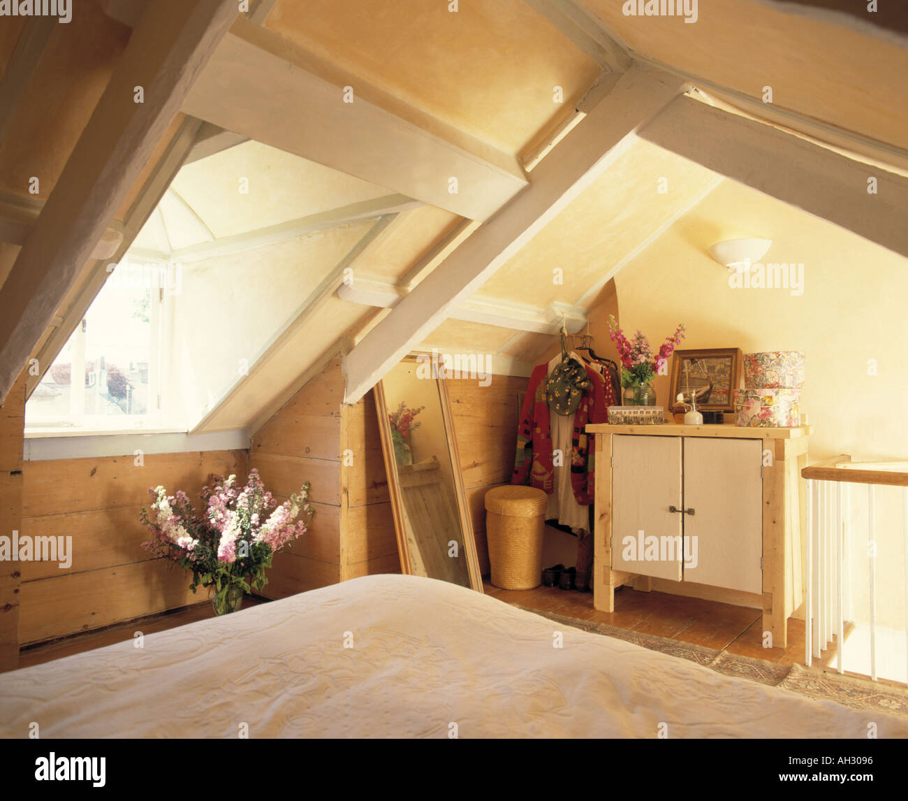 Velux window above bed in attic bedroom with simple economy-style cupboard & Velux window above bed in attic bedroom with simple economy-style ...