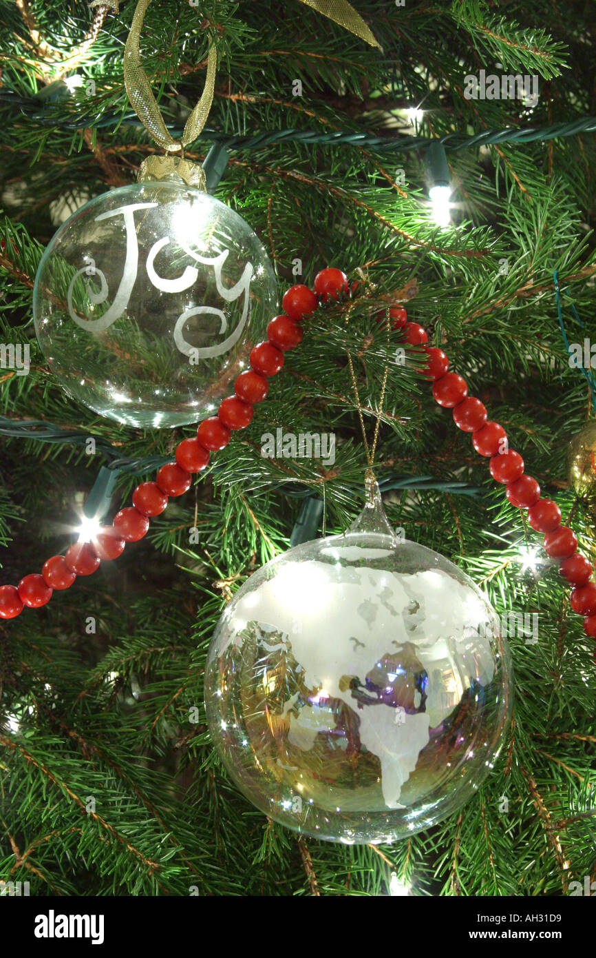 Ornaments On Christmas Tree With Joy To The World Theme Stock Photo