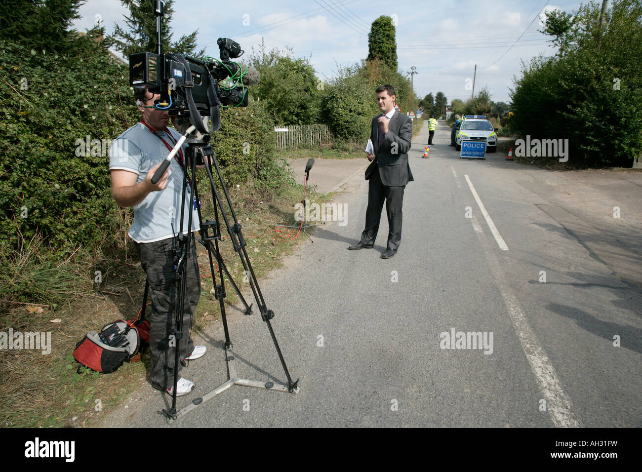An ITN News crew prepares to send a live feed to report on