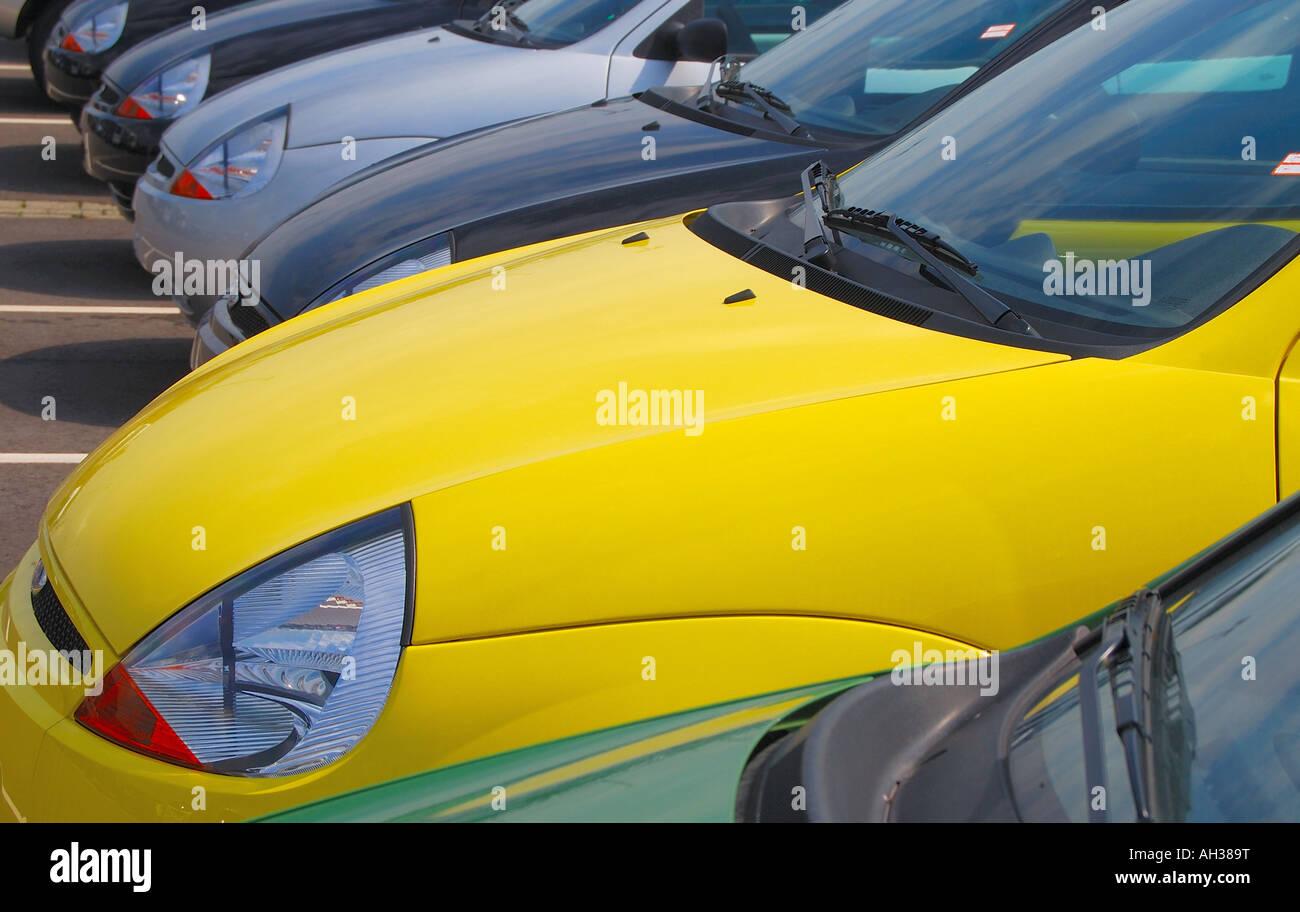 Striking Yellow Ford Ka In Parking Lot Among Many Grey Cars Stock Image