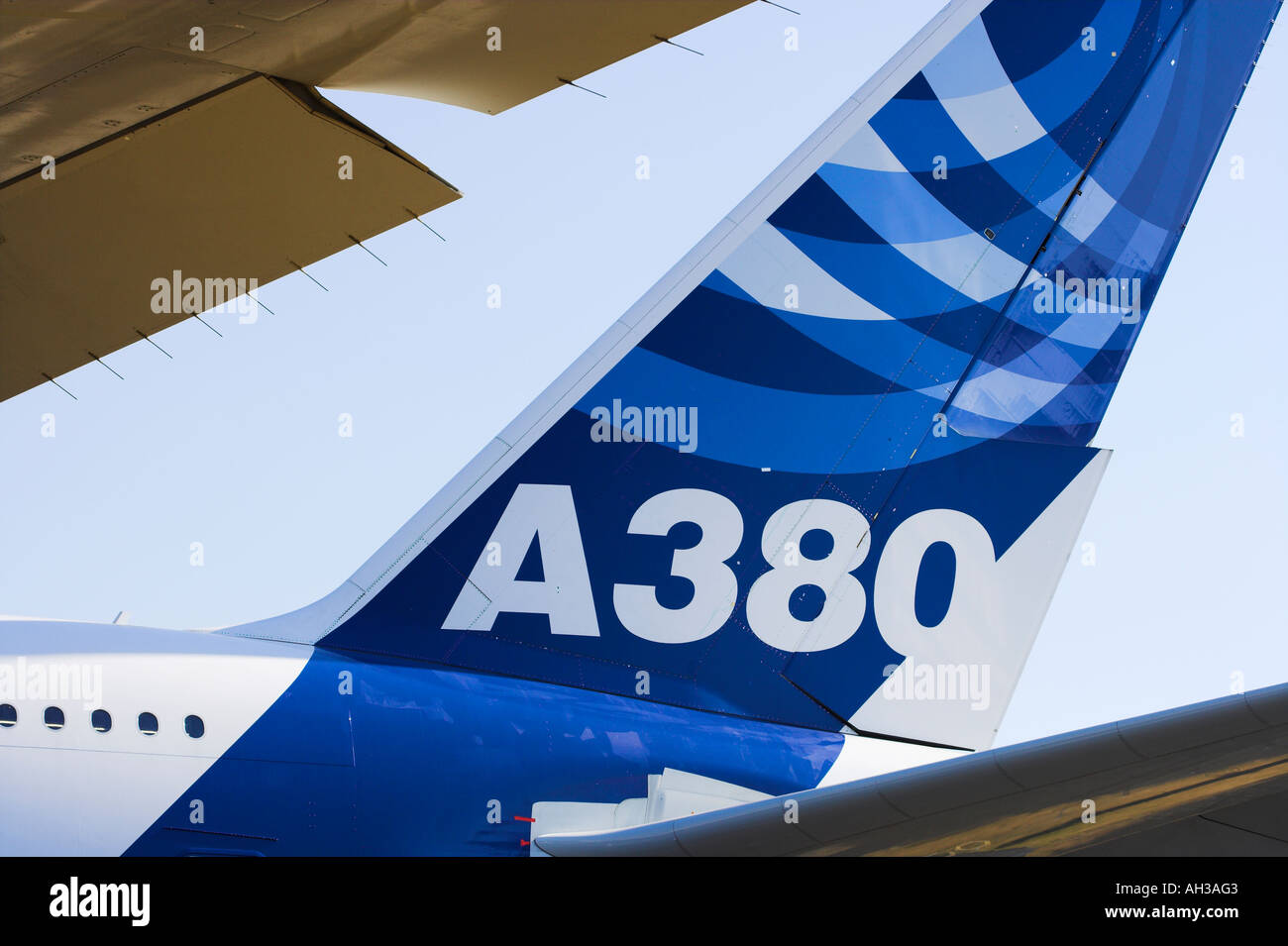 A380 Airbus tailfin framed by wing and tailplane - Stock Image