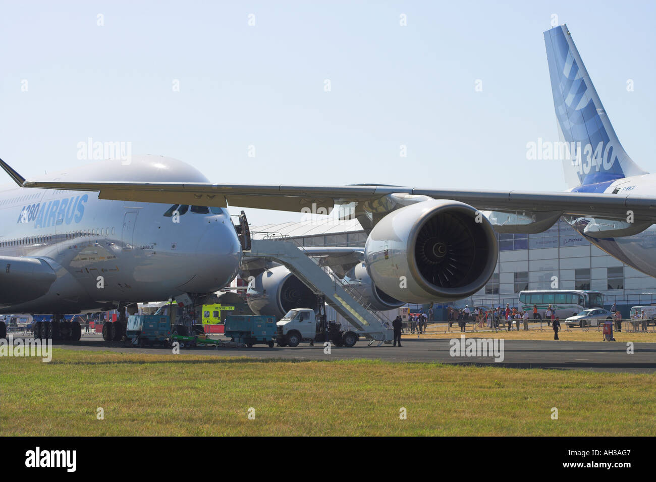 Airbus A340 600 rear with A380 behind - Stock Image