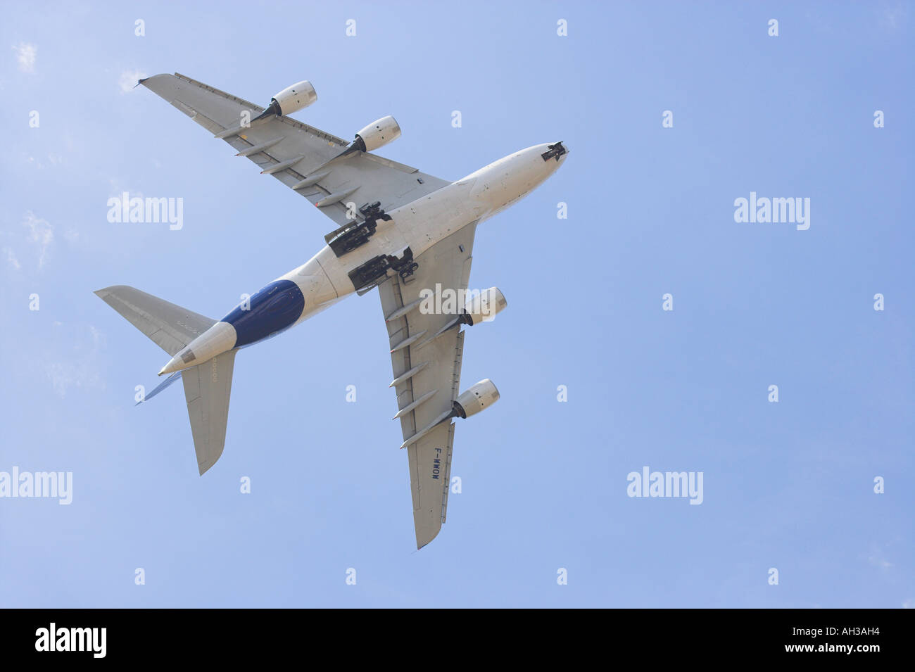 Airbus A380 from underneath climbing away at Farnborough - Stock Image