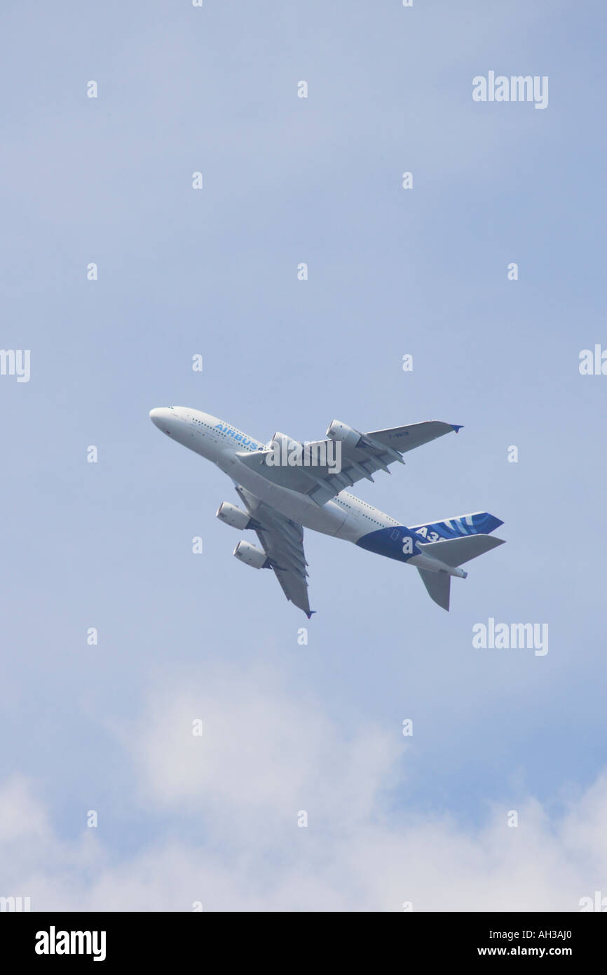 A380 Airbus climbing above the clouds - Stock Image