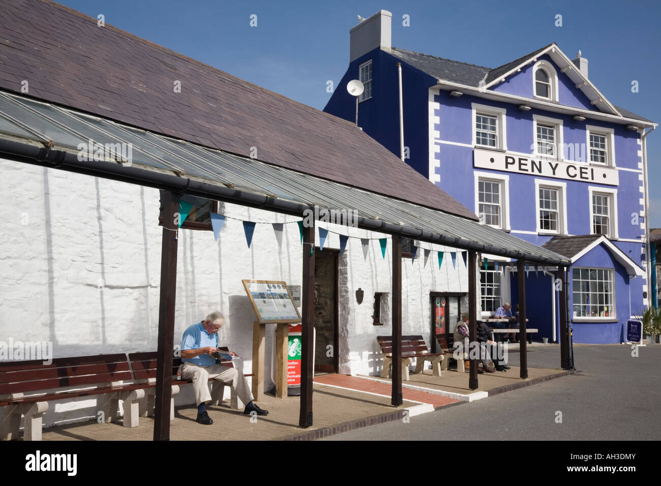 Colourful purple painted Harbourmaster Hotel Pen Y Cei and Tourist Information building on Quay Parade Aberaeron - Stock Image