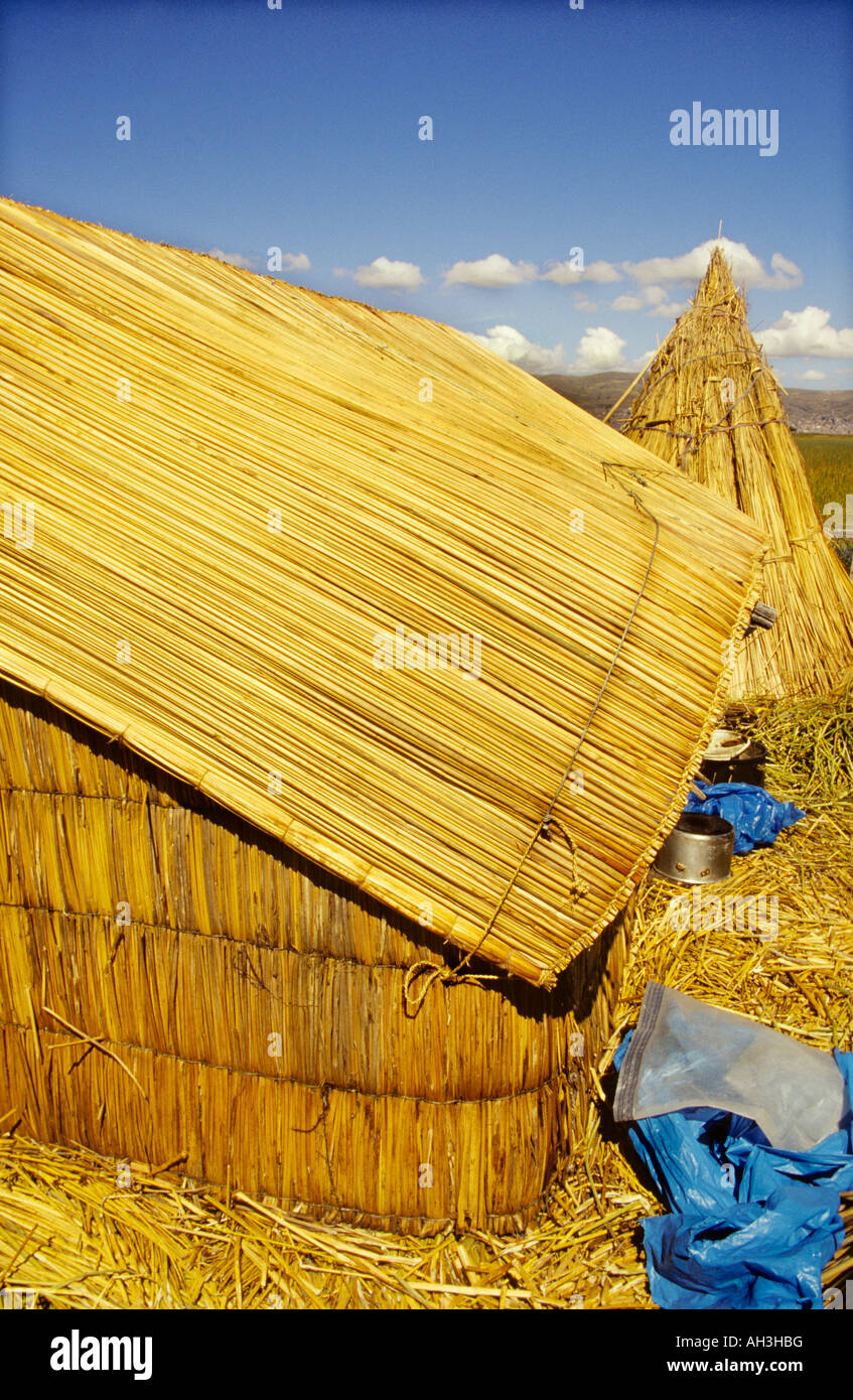 Floating islands and Huts made of reed. Uros peoples of lake Titikaka. - Stock Image