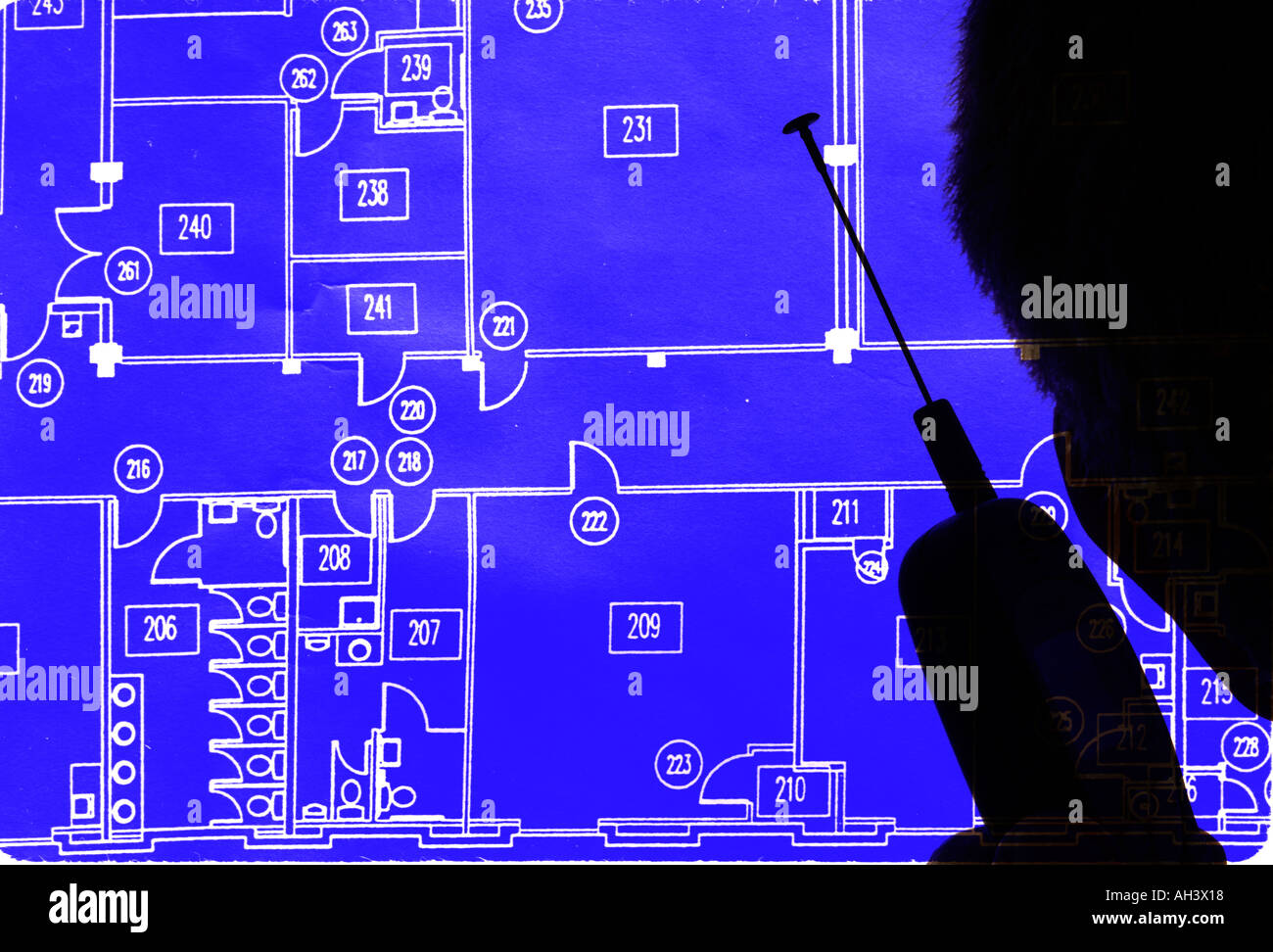 silhouette man with cell phone viewing blueprint - Stock Image