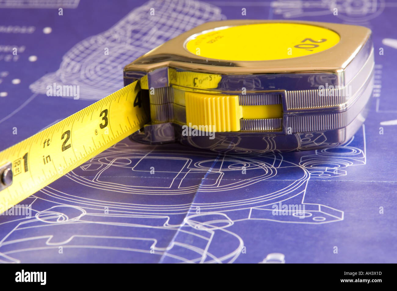 Tape measure on top of blueprints - Stock Image