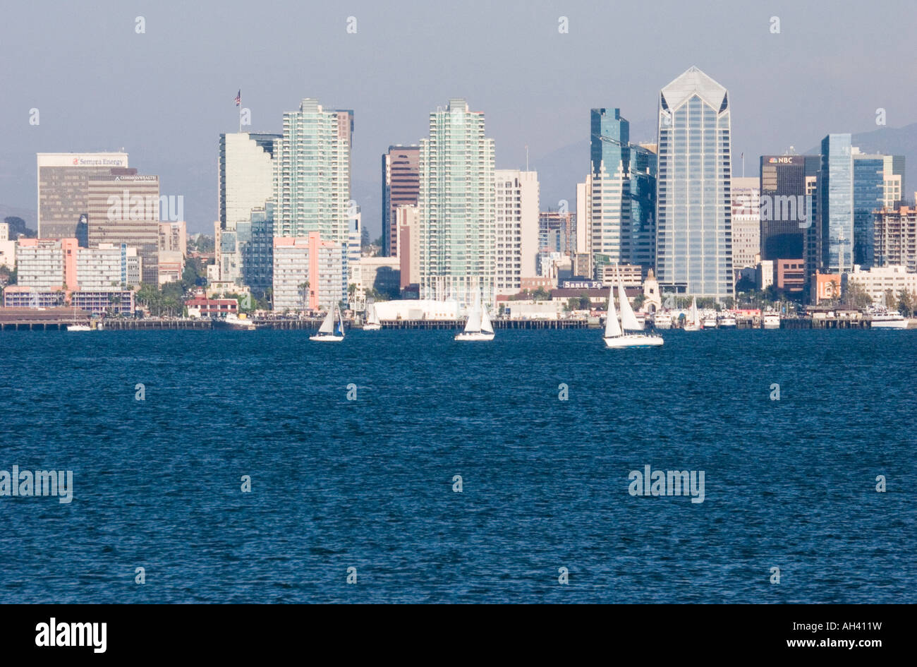 The San Diego Skyline On A Beautiful Summer Day With Sailboats And Deep Blue Water Of Bay In Foreground