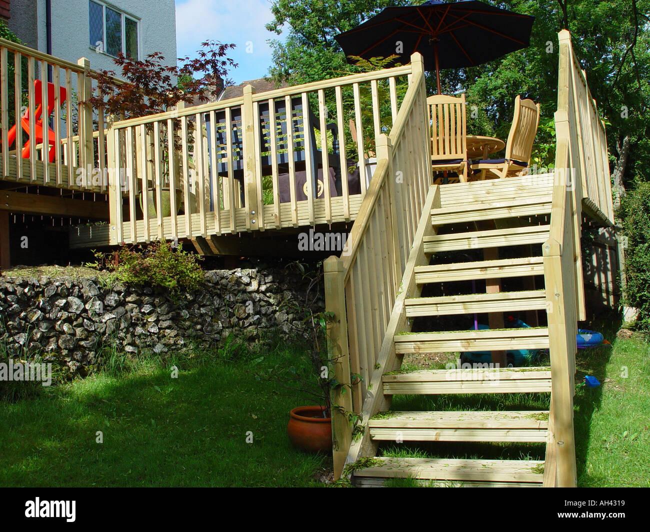 decking staircase from garden deck into garden includes balustrades - Stock Image