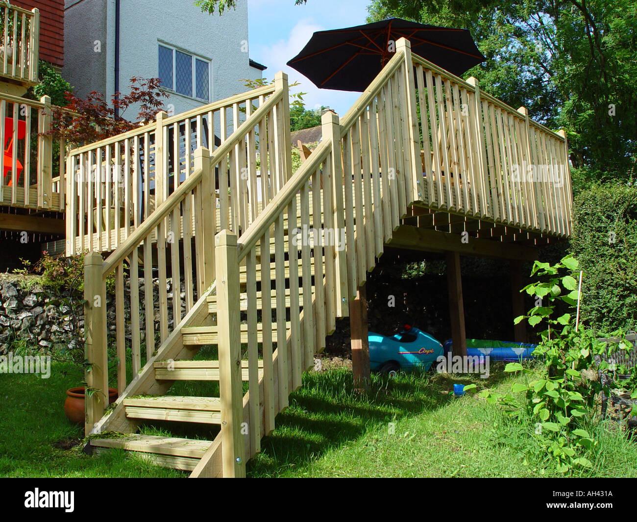 Decking Staircase Construction From Garden Deck Into Garden Includes  Balustrades   Stock Image
