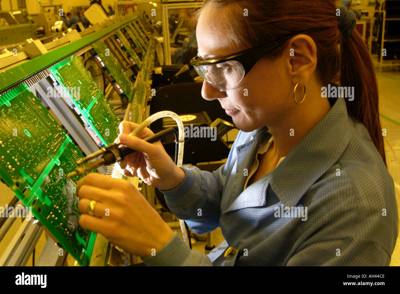 Tremendous Production Operator Soldering Circuit Boards At Axiom Manufacturing Wiring 101 Cabaharperaodorg