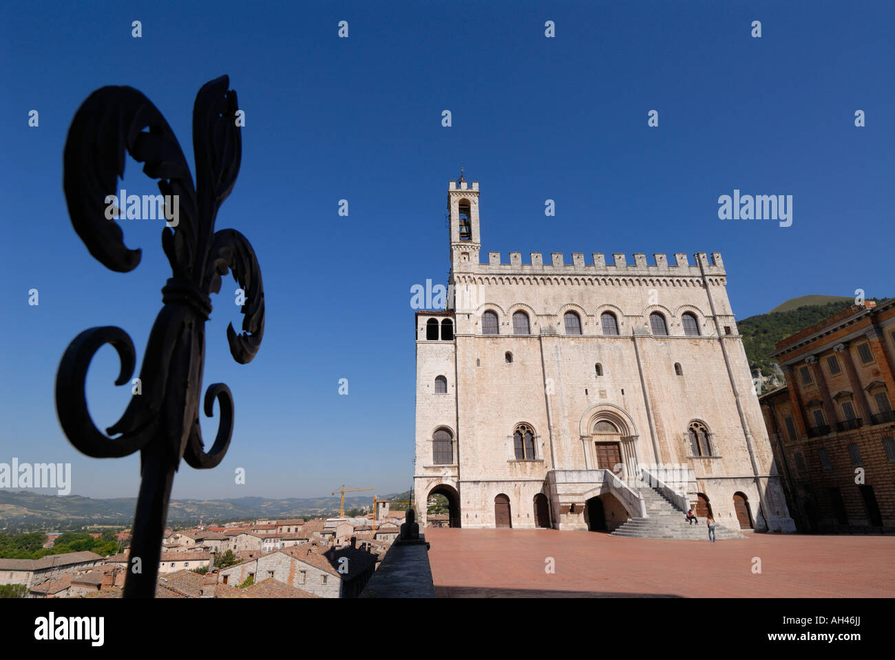 Gubbio Umbria Italy Palazzo dei Consoli and the wrought iron Fleur de Lys a motif found throughout the town - Stock Image