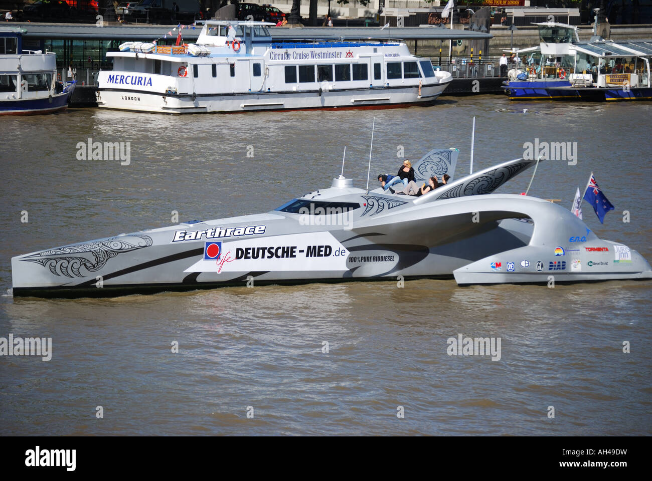 Futuristic powerboat 'Earthrace' cruising on River Thames, London, England, United Kingdom - Stock Image