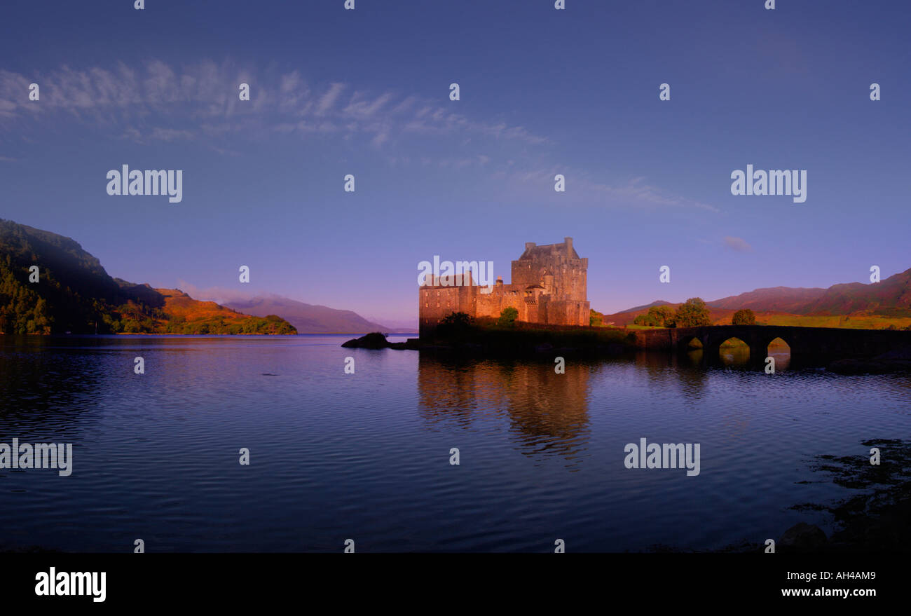 Eilean Donan Castle and mirror reflection in lake, Loch Duich, Dornie, Scotland Stock Photo